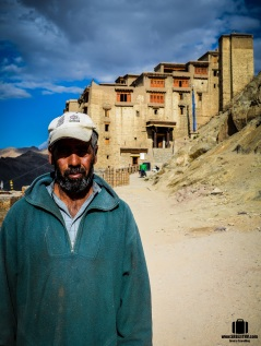 A laborer in front of the palace