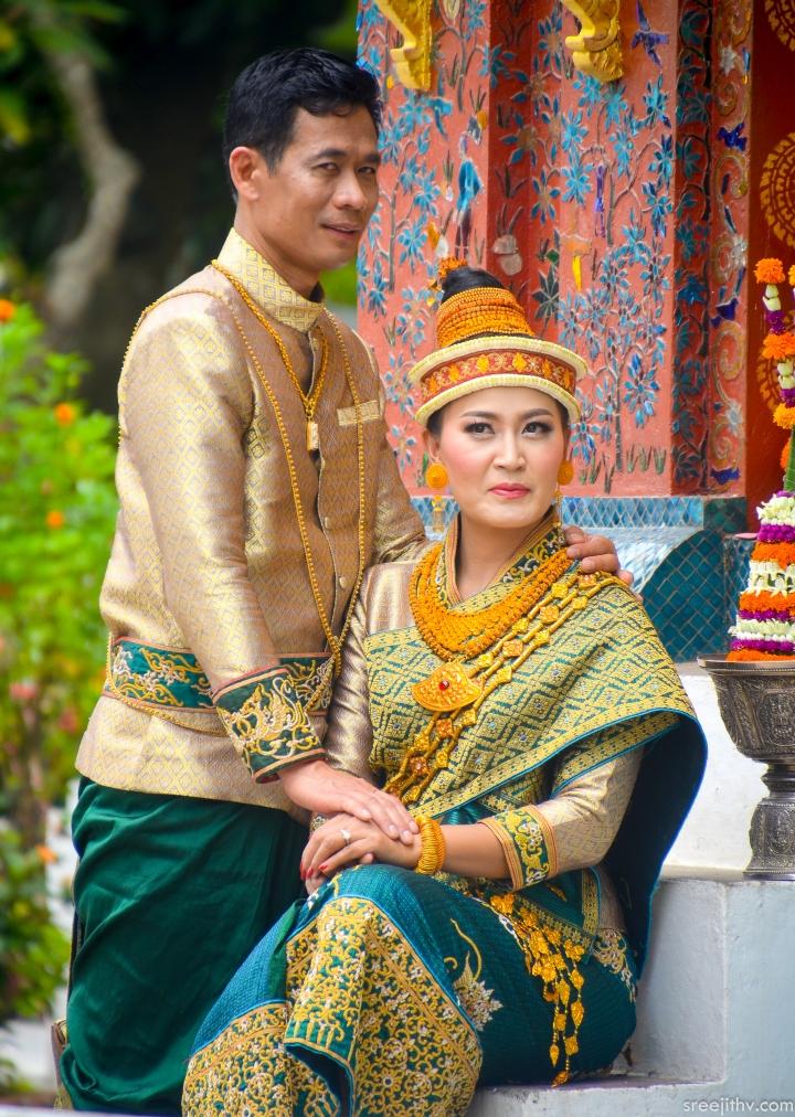 Traditional cloths Bride: Singh and Suea pat underneath Pha Biang Groom: Variant of Raj Pattern