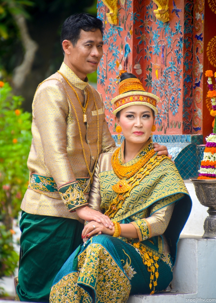 Traditional cloths Bride: Singh and Suea pat underneath Pha Biang Groom: Variant of Raj Pattern