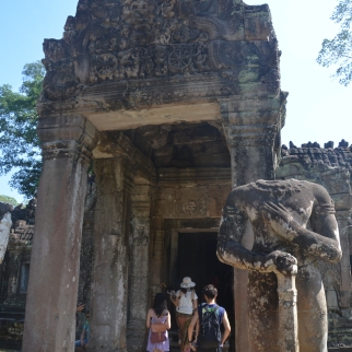 Headless Dwarapala (guard) at Preah Khan