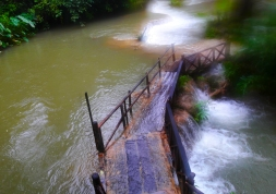 Wooden walkway at Tat Kuang Si falls, Laos