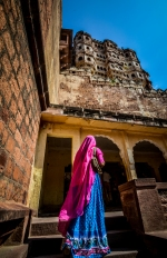 A woman in colorful traditional Rajasthani attire at Mehrangarh Fort, Jodhpur