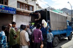 Milk van: People waiting to collect milk