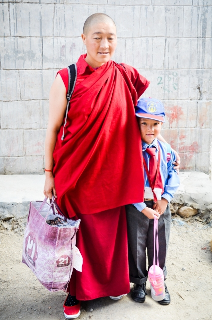 Buddhist nun and a school girl