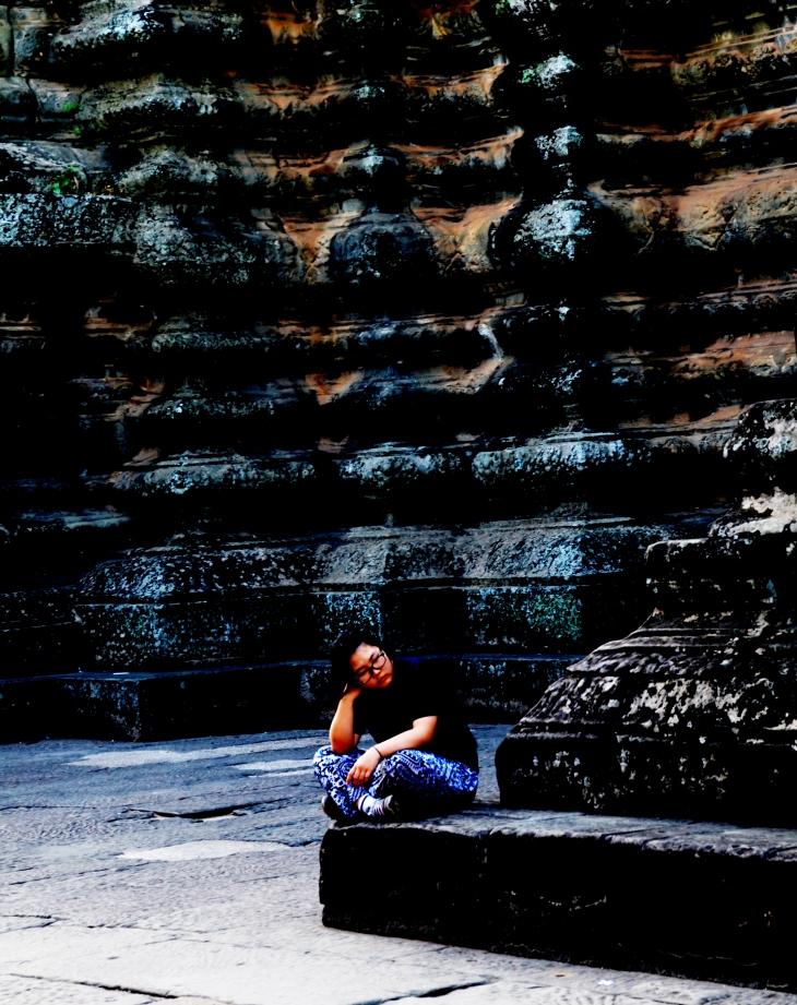 Girl waiting at Angkor Wat, Cambodia